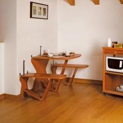 Chairs For Kitchen Table Used Cabinets Sale Craigslist 小空間大利用 餐桌餐椅也有隱形斗篷 A Lifetale 生活童話讀創意 買創意 當牆面上的兩片白色板子放下變成了板凳與餐桌 頓時將空間成為完整的餐廳 底部的支架向下折開穩固桌椅使用方式相當簡便 其面積厚度只有4公分 當使用完畢收起牆面上