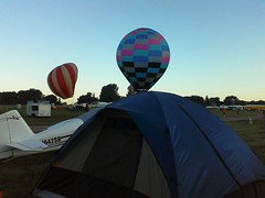 Oshkosh~where you wake @ 6 to sound of a hot air balloon outside your tent. by ladywriter47