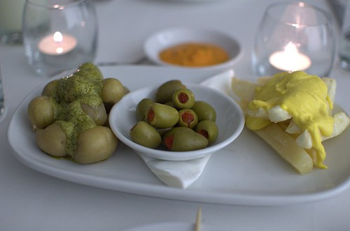 New potatoes with ocopa sauce, rocoto-stuffed olives, cassava chips with huancaína sauce