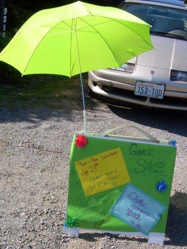 Sale sign with umbrella