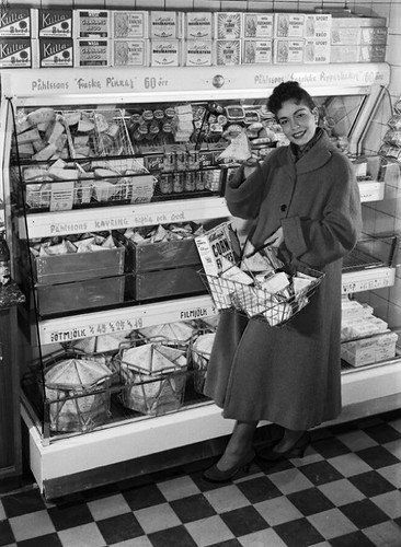 Tetra Pak® - Housewife at the dairy counter in...