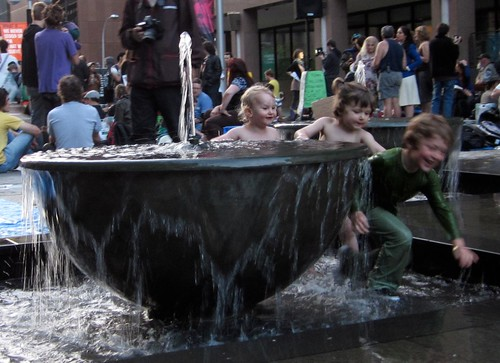 small children frolicking in a fountain at Martin Place, Sydney