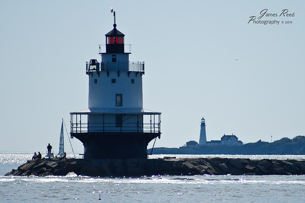 A pair of lighthouses along the New England coast.