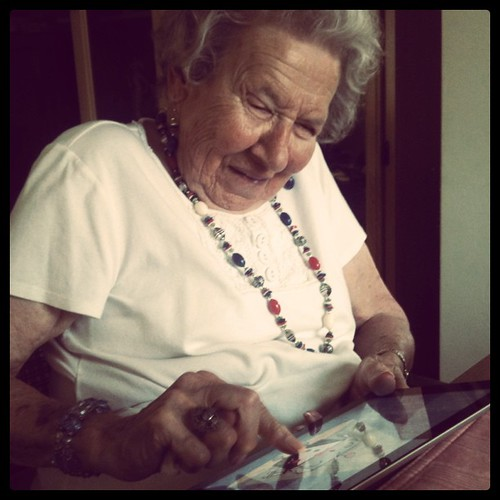 My grandma playing with my iPad happily.
