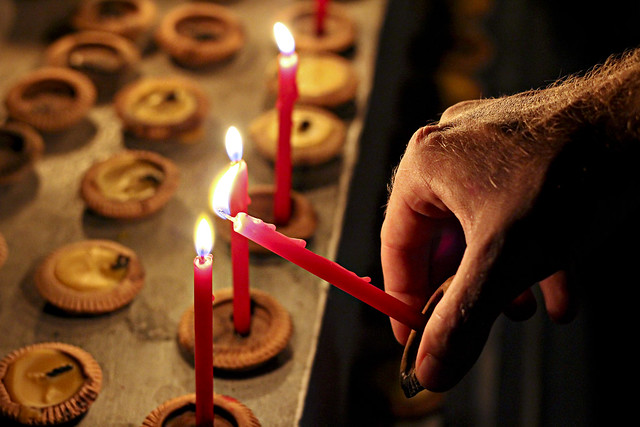 travis lighting candles