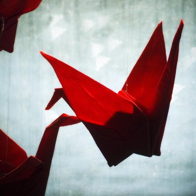 red fabric origami cranes