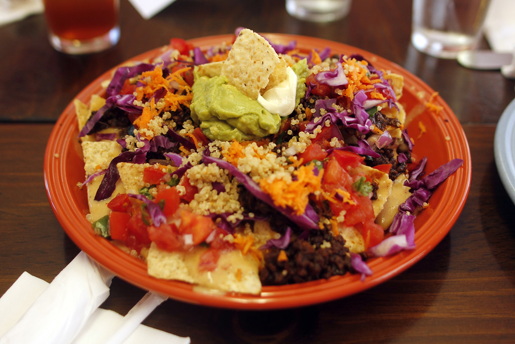 A hearty pile of Vegan Nachos at Vegeria
