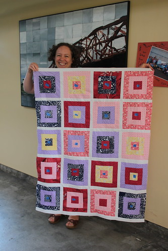 Caitlin with a beautiful quilt top