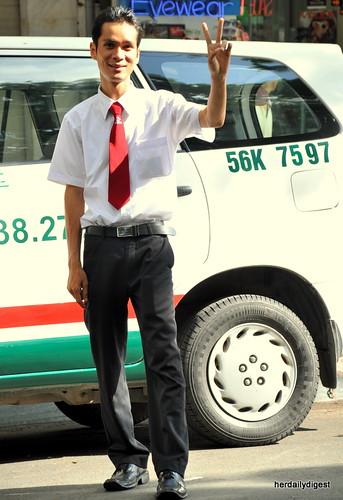 Another peace-signer. Vinasun's taxi driver
