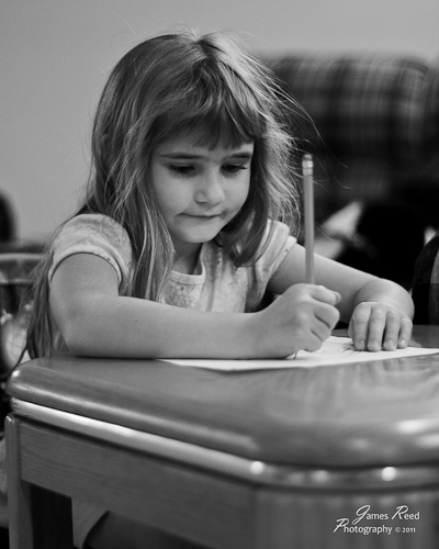 The little one works at her impromptu desk.