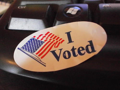 I Voted sticker  with image of an American Flag stuckon computer keyboard