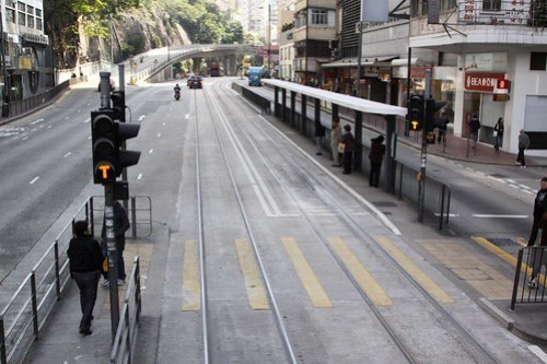 Orange 'T' for proceed at at Hong Kong Tramways pedestrian crossing