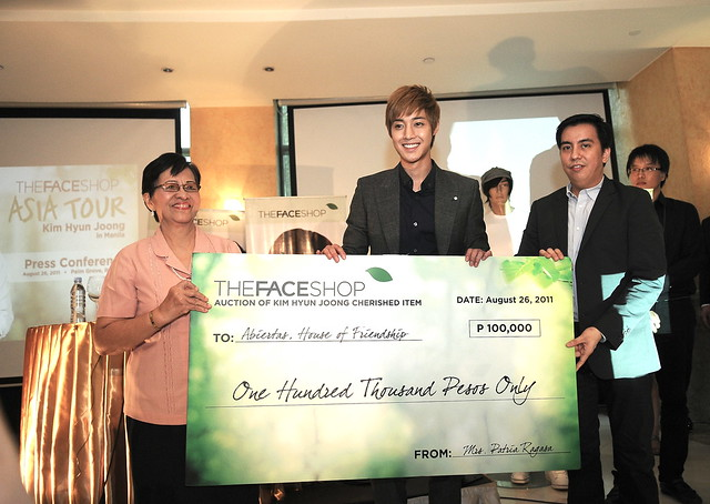 KHJ WITH MR. BRYAN LIM FOR CHEQUE TURN OVER TO ABIERTAS HOUSE OF FRIENDSHIP REPRESENTATIVE MRS. PURITA CAJUIAT