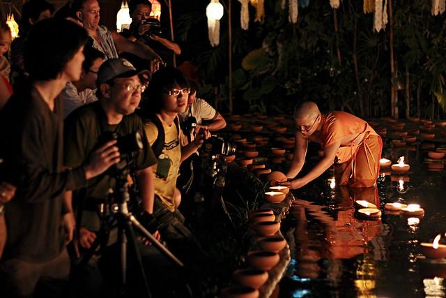 monks vs. photographers