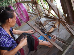 Spinning to get spools of silk thread, Ock Pop Tok, Luang Prabang