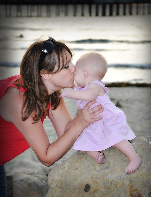 Mommy and Kyla share a kiss.