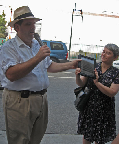 09-25-11-CA-LA-LAVA walking tour-Richard Schave lectures, Kim Cooper holds up photos on iPad.jpg