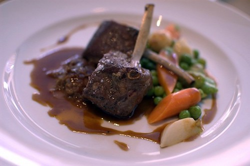 Pan roasted rack of lamb, braised shoulder, spring vegetables, vin santo reduction