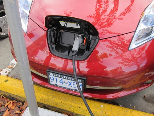 Leaf charge port in hood