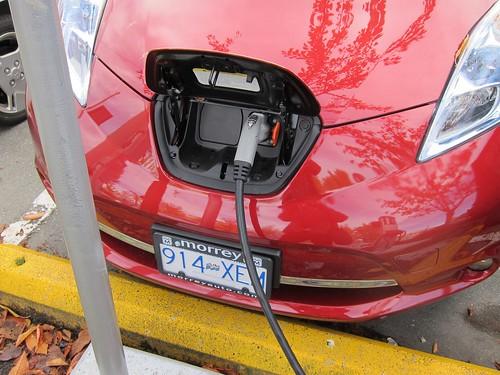 Leaf charge port in hood