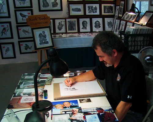 side view of MarkTumber working on a commissioned drawing by William J. Gibson, the Canuckshutterer