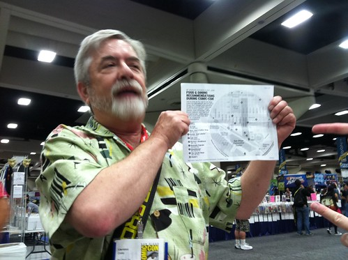 Reader with a printout of the map