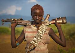 Bana girl with gun - Omo valley Ethiopia
