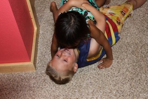 Kaidence tips Brady over with a huge hug