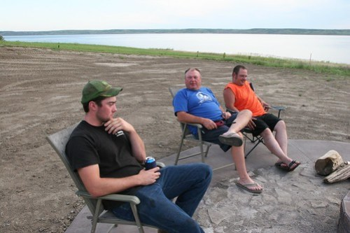 James Dad and Damon chat by the fire
