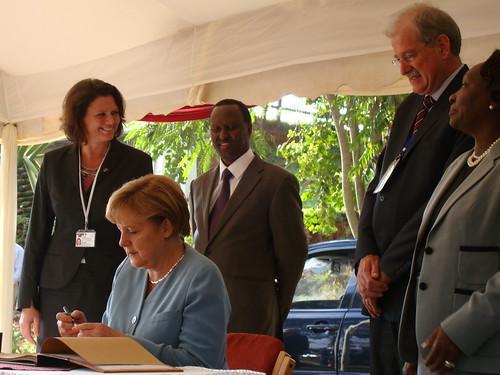 Merkel visits ILRI Nairobi: The Chancellor signs ILRI's visitors' book