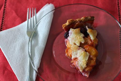slice of nectarine and blackberry pie