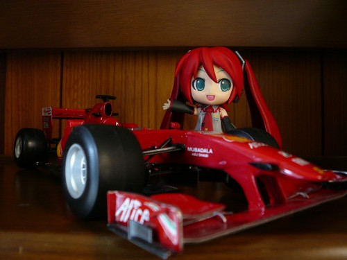 Posing with Ferrari's racing car for F1