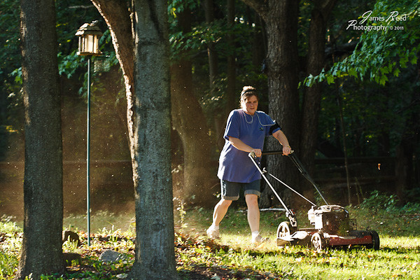Grass clippings fly as the wife battles the overgrown - and still wet - lawn.