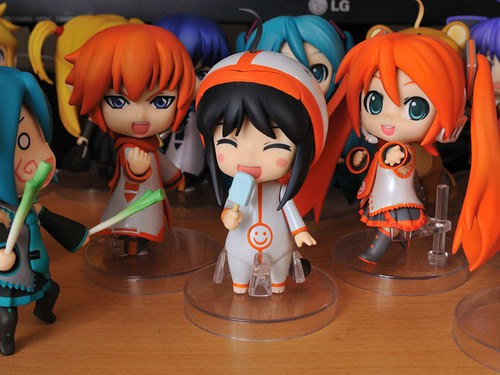 Nendoroid Mikatan, along with orange KAITO and Miku
