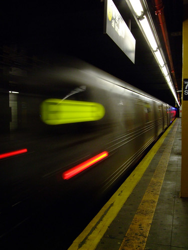 Subway train leaving station by S.Stikine 