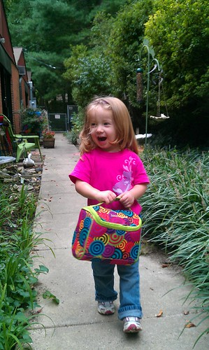 My daughter, holding her hermetically-sealed lunchbox