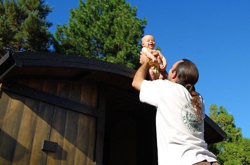 smiling laughing baby on a roof