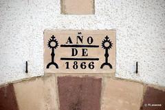 Inscripción en la puerta de una casa de Burguete