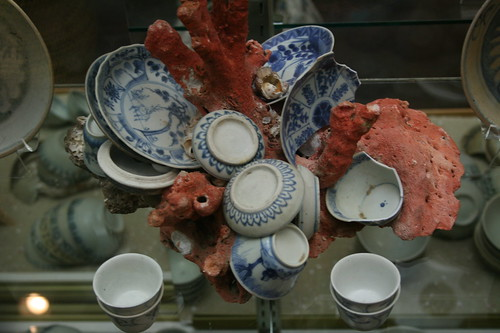 Dishes encrusted in coral