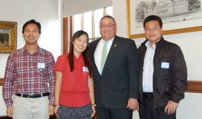 Three Chinese guest teachers pose with Maine Gov. Paul LePage.