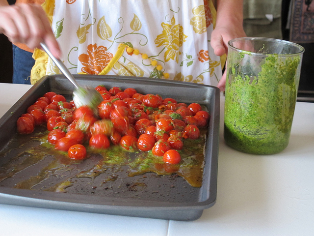 14. Tossing tomatoes w pesto