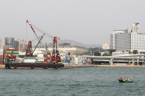Tiny little fishing boat off Hung Hom