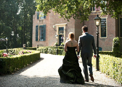 Bride and groom walking towards the venue