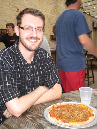 Craig with sausage pizza