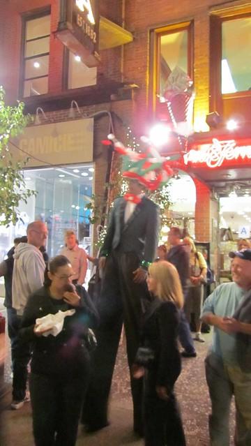 fest of san gennaro. man on stilts.