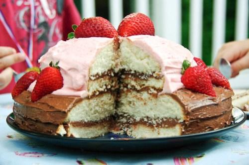 Quadruple layered vanilla cake with chocolate and fresh strawberry icing...