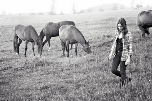 Black Mountain Colorado Dude Ranch woman walking horses