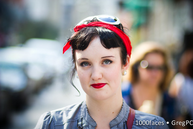 Face - a woman with red lips and a red headband.