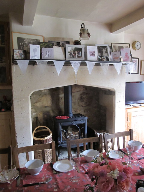 My mum celebrated my brother's wedding with home made bunting and all the family wedding pics on the mantelpiece