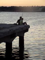 Children fishing at dusk